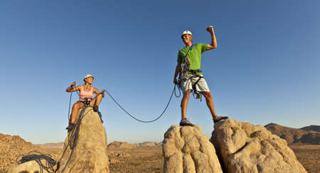 Team of rock climbers struggle to the summit of a challenging cliff. Stock Photo - 12452107