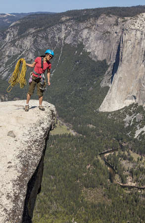 Climber peers over the edge of an abyss in Yosemite National Park, Stock Photo - 13614779