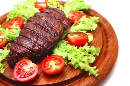 served roasted beef steak on plate photo
