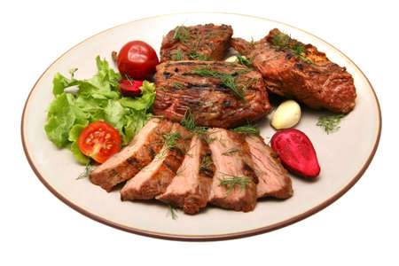 served roasted beef steak on color dish Stock Photo