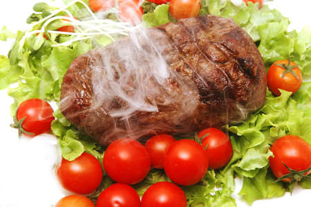 smoked meat and vegetables on transparent dish Stock Photo