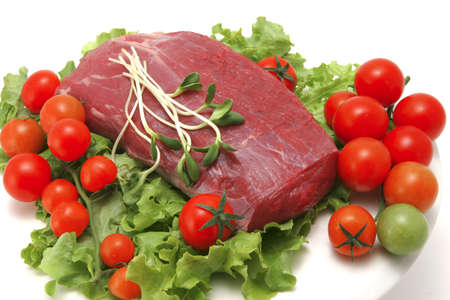 raw fresh beef meat and vegetables photo