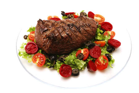 meat and vegetables on transparent dish Stock Photo
