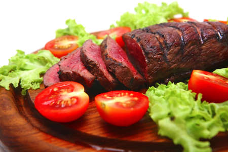 roast beef red meat on wooden plate Stock Photo