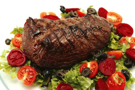 roast meat served on transparent dishware Stock Photo
