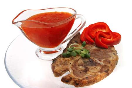 crusted: roast lamb steak and hot chili sauce Stock Photo