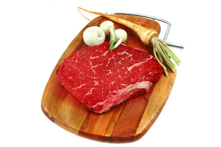 red raw meat and vegetables on board Stock Photo - 4235716
