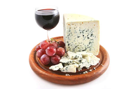 roquefort cheese and wine glass with grapes photo