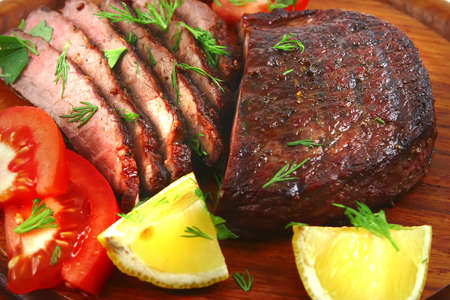 roast beef meat slices with vegetables photo