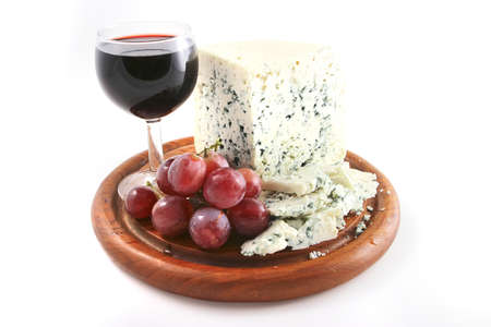 roquefort: roquefort cheese and wine glass with grapes Stock Photo