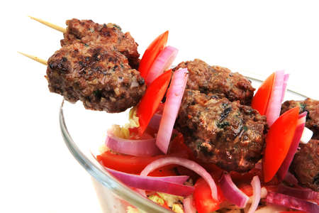 shish kebab with salad over white background photo