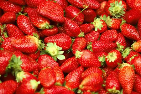 strawberry heap on market show window photo