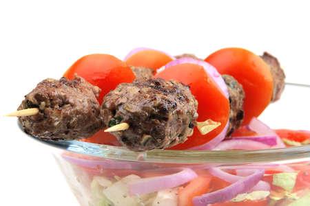 고기의: roast meaty shish kebab served with salad