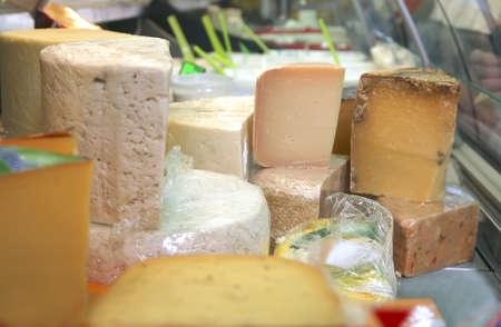 different types of cheese on market show window Stock Photo