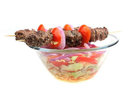 greek meat kebab on big transparent salad bowl Stock Photo - 4552777
