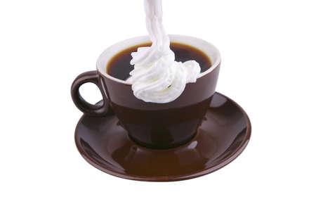 hot coffe with cream over white and chocolate cream photo