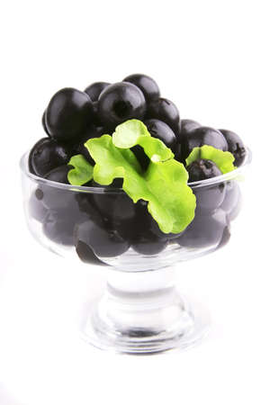 black olives set on white background with salad front photo