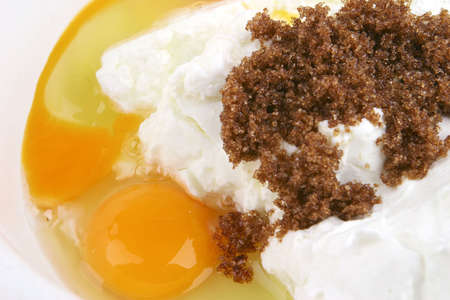 white cottage cheese with broken egg  and brown sugar photo