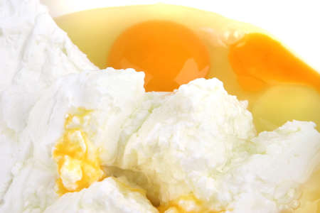 white cottage cheese with broken egg front view photo