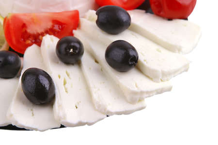 soft feta cheese served with black olives photo