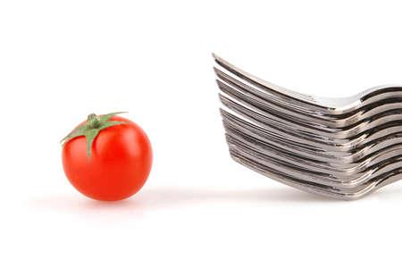 forks and single tomato Stok Fotoğraf