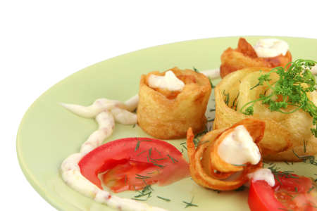 served fried potatos with vegetables on green dish photo