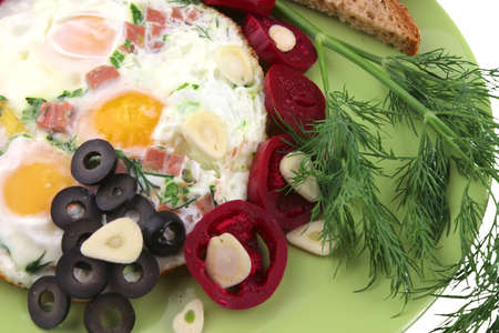 fried eggs and vegetables photo