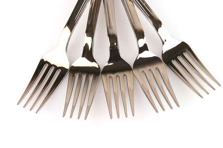 five metal forks over white background over white