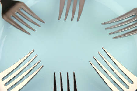 six forks on blue dish Stock fotó
