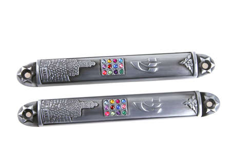 mezuzah: two silver metal mezuza cases over white Stock Photo