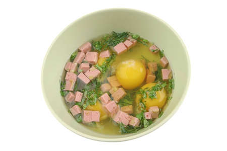 eggs with greenery and sausage in big bowl photo