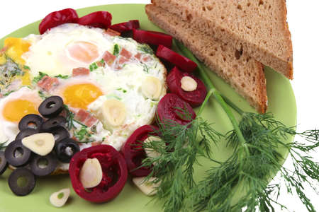 roast eggs served with vegetables and bread photo