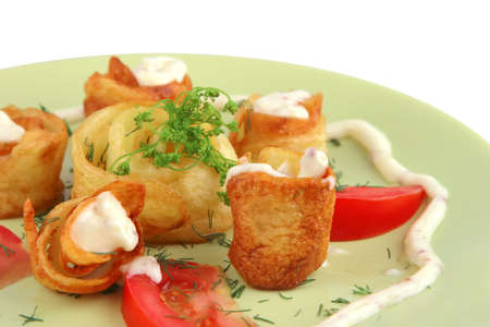 served potatos with sauce on light dish photo