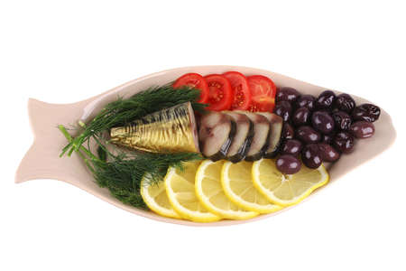smoked fish served with vegetables top view photo