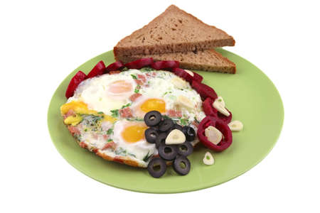 servd fried eggs with vegetables on green dish photo
