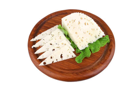 white goat cheese and salad on wood shelf over white photo