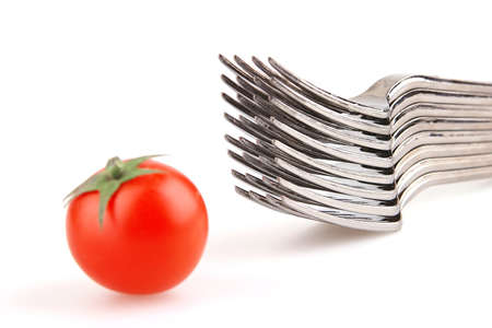 forks and tomato isolated over white background photo