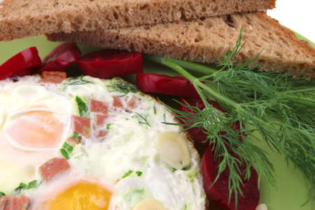 fried eggs and snacks with fennel on dish photo