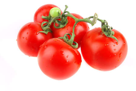 fresh uncooked tomato close up over white photo