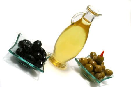 gold olive oil and olives over white photo