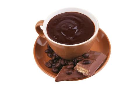 glas: hot liquid chocolate and chocolate bar over white