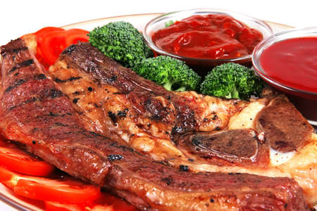 roast juicy fat steak and red hot sauces photo