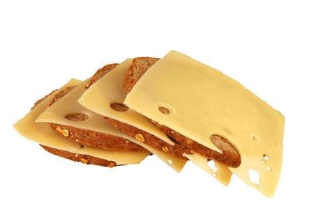 cheese slices and bread over white background photo