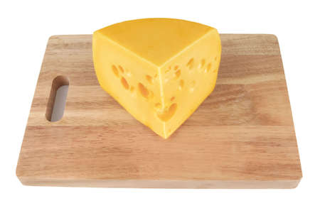 big chunk of yellow cheese over white on board photo