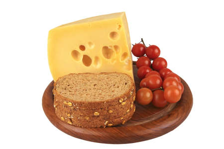 big chunk of yellow cheese with cherry tomatoes and bread Stock Photo - 4890746