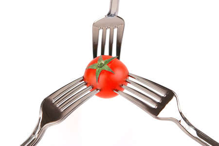 three forks and tomato over white background Stock fotó