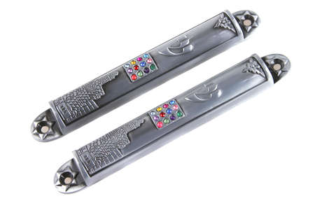 mezuzah: two metal mezuzas cases  over white background