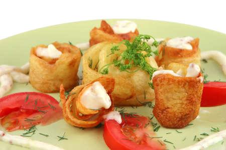 served potatos with sauce on light dish photo