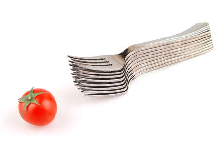 forks and tomato isolated over white background