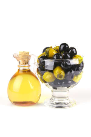 olive oil and olives over white background photo